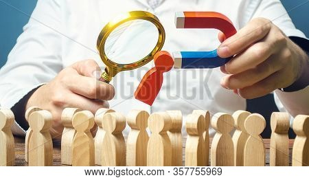 Businessman Examines Best Candidate For Work With A Magnifying Glass. Recruiting New Workers, Headhu