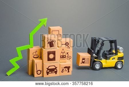Forklift Next To Boxes And Green Up Arrow. Logistics, Transport Infrastructure. Growth Of Online Dis