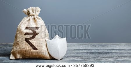 Indian Rupee Money Bag And Protection Shield. Ease Doing Business. Attractive Lending Conditions, Ru