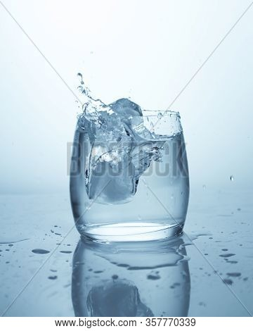 Drop Of Ice In A Glass Of Water. Pure Spring Drinking Water, Drops Of Water, Splash, Clear Liquid