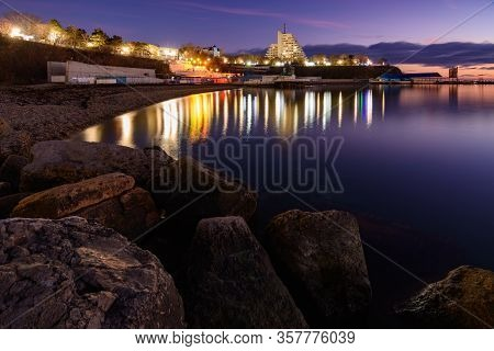 Anapa, Russia - February 17, 2020: View Of The Small Bay Of The City Of Anapa Resort After Sunset