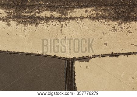 Texture Of Old Used Faux Leather With Cracks. Worn Fabric On The Couch Cushions. Background Faux Lea