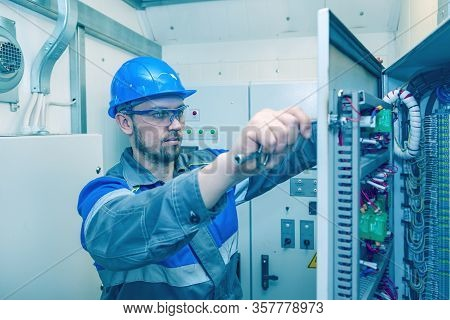 Energy And Electricity, Electromechanical Protective At Work With An Electric Panel, An Electrician