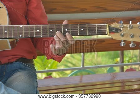 Bongaon, West Bengal, India, 25 January, 2020: Close Of Hand And Fingers Playing Guitar Strings And