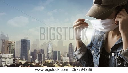 A Tourist Wearing A Mask Isolated On City Background. Promoting People Use Face Mask To Protect Them
