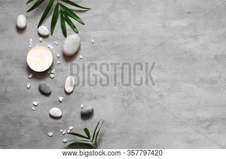 Spa Concept On Stone Background, Palm Leaves, Candle And Zen, Grey Stones, Top View, Copy Space