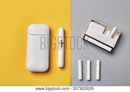 Electronic Cigarette Technology. Tobacco Iqos System. Close-up An Electric Hybrid Cigarette With A H