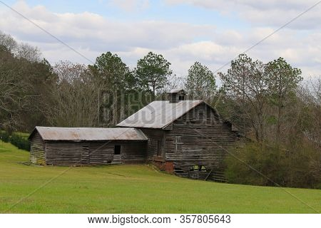 Old Vintage Riverbank Country Farm Barn Building Sunny Cloudy Sky