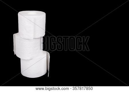 Stack Of Three Rolls Of Toilet Paper Isolated On Black Background. Three White Toilet Paper Rolls Is