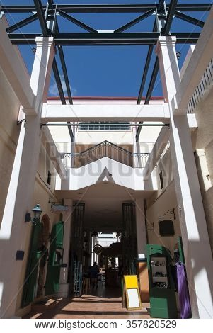 The Narrow Passageway Through Buildings With Small Boutiques And Cafes In Charlotte Amalie Downtown