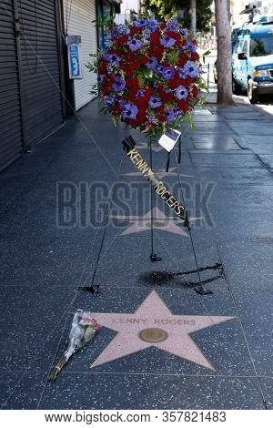LOS ANGELES - MAR 21: Kenny Rogers star as a wreath is placed at the star of Kenny Rogers on the Hollywood Walk of Fame on March 21, 2020 in Los Angeles, CA. Rogers died late Friday at the age of 81.