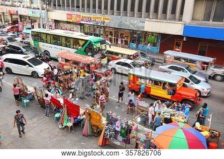 Manila, Philippines - November 25, 2017: People Drive In Heavy Traffic In Manila City, Philippines.