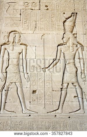 Wall With Ancient Hieroglyphs Of Karnak Temple Drawings, Luxor, Egypt