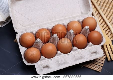 Ten Eggs Lay In A Cardboard Box On The Table