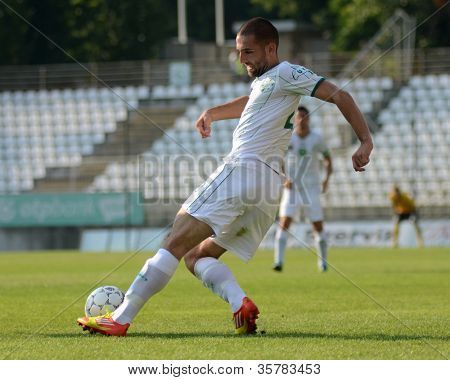 KAPOSVAR, HUNGARY - AUGUST 4: Unidentified player in action at a Hungarian National Championship soccer game Kaposvar (white) vs Debrecen (red) August 4, 2012 in Kaposvar, Hungary.