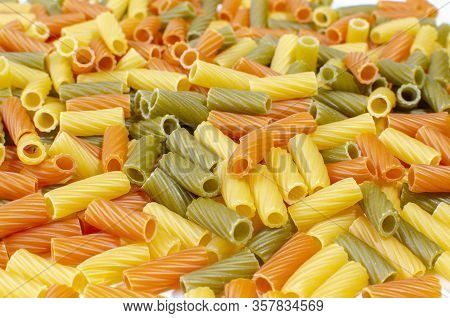A Variety Of Types And Forms Of Dry Italian Pasta. Background Of Colored Species