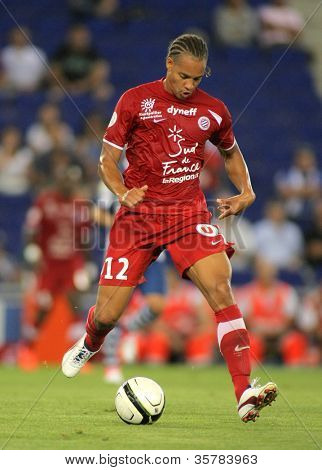 BARCELONA - AUG, 3: Daniel Congre of Montpellier HSC in action during a friendly match against RCD Espanyol at the Estadi Cornella on August 3, 2012 in Barcelona, Spain