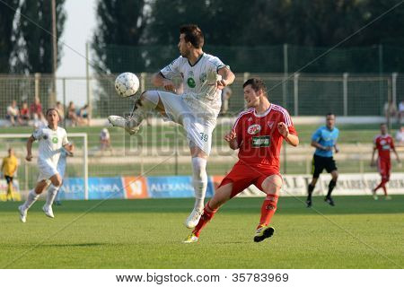 KAPOSVAR, HUNGARY - AUGUST 4: Bojan Vrucina (white 19) in action at a Hungarian National Championship soccer game Kaposvar (white) vs Debrecen (red) August 4, 2012 in Kaposvar, Hungary.