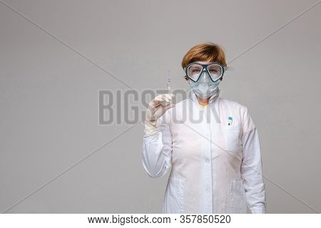 Doctor With A Syringe In Hand. Stock Photo Portrait