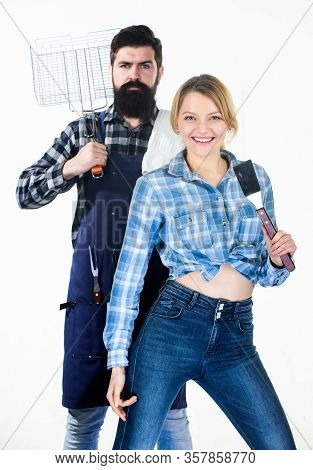 Essential Barbecue Dishes. Bearded Hipster And Girl Hold Cooking Grilling Utensils White Background.
