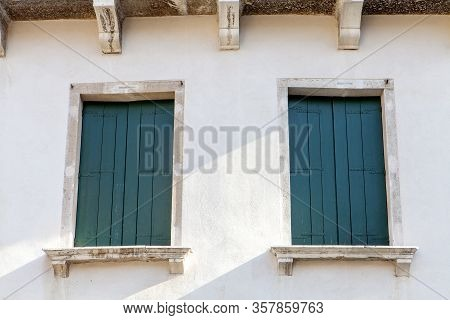 A Close Up Of The Old World Green Shutters In The Window In Venice Italy
