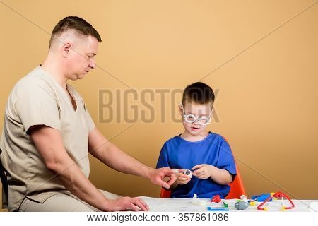 Medical Examination. Boy Cute Child And His Father Doctor. Hospital Worker. First Aid. Medical Help.