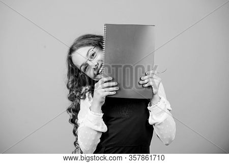 School Exam Concept. Final Exam Coming. Girl Hold Textbook Folder Test. Preparing To Exams In Librar