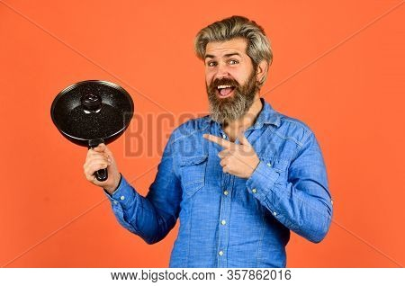 Bearded Man Cooking In Kitchen. Culinary And Cuisine. Kitchen Utensils. Healthy Food Cooking. Cookin