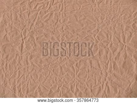 Crumpled Kraft Paper. Textured Vintage Background. Stock Photo.