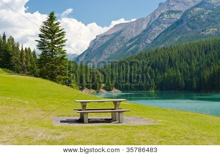 Picnic table at the beach of a lake, Vancouver, Canada