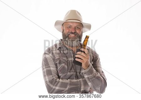 An Aussie Man Relaxing With A Cold Beer.