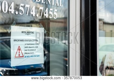 Surrey, Canada - March 25, 2020: Sign On Front Door Of Dental Office Announcing Closure During Coron