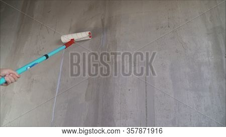 Paint The Bare Wall With A Paint Roller. Hand Painted By Roller. Primer Wall Roller
