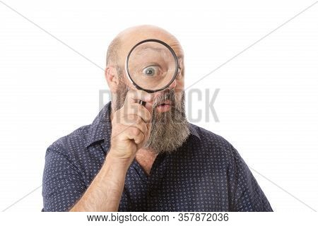 A Person Looking Through Magnifying Glass With An Astonished Expression.