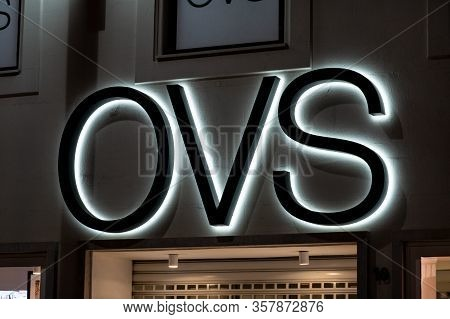 Palermo, Sicily - February 8, 2020: The Logo Of The Oviesse (ovs) Fashion Store At Night Which Sells