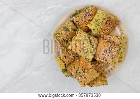 Baked Cornbread With Spinach And Served On The Plate