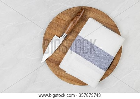 Flatlay Above Kitchen Dishcloth And Knife On The Wooden Board