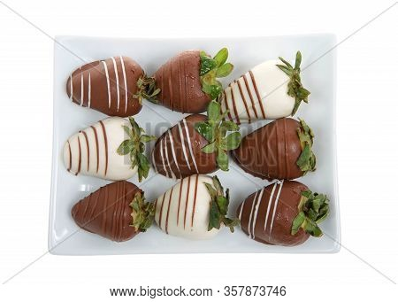 Top View Of Rectangular Porcelain Plate Of Giant Strawberries Dipped In White And Milk Chocolate, Dr