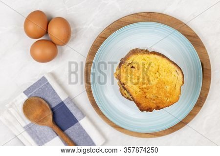 Flatlay Above French Toast Served With Dishcloth And Kitchen Utensils On The Table