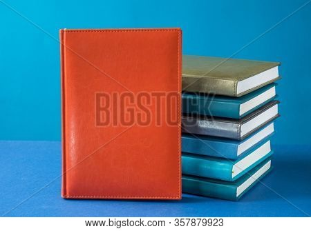 Stack of books on the table, copy space for text on the cover.
