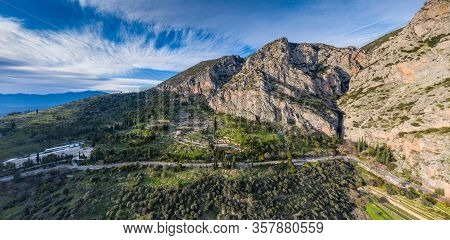 Aerial View Of Antique Theatre And Apollo Temple In Delphi, Greece At Sunrise, Famous Archaeological