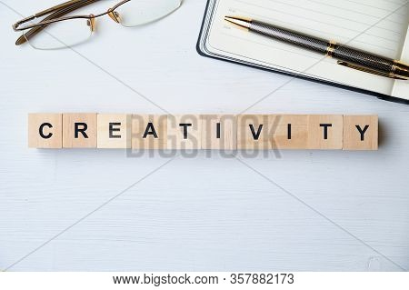 Modern Business Buzzword - Creativity. Top View On Wooden Table With Blocks. Top View. Close Up.