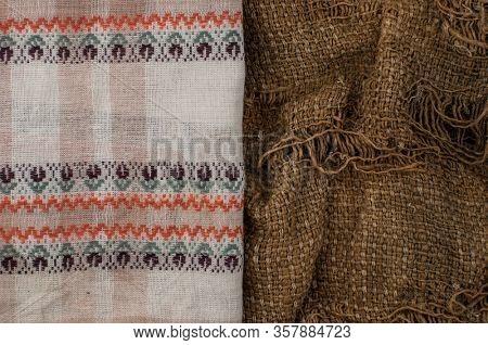 colorful napkin lying on burlap hessian sacking texture