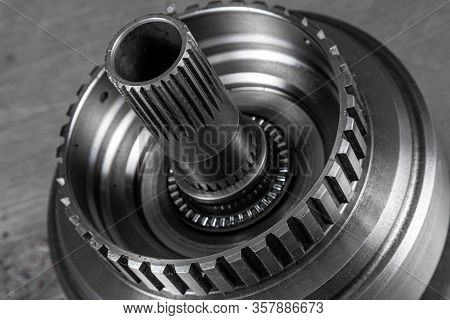 Close-up Of A Car Gearbox Part. Metallic Shiny  Gear Differential For Planetary Gearshift. Industria