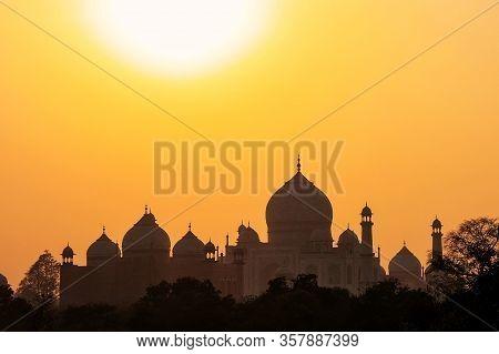 Silhouette Of Domes And Minarets Of Taj Mahal At Sunset, Agra, Uttar Pradesh, India. Taj Mahal Was D