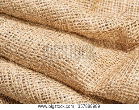 Close Up View On Brown Crumpled Burlap Textile. Abstract Background Of Brown Sackcloth. Texture Of B