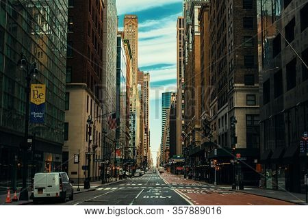 NEW YORK, USA - MARCH 21, 2020: Empty street with few pedestrians and traffic as the result of COVID-19 coronavirus pandemic outbreak in New York City.