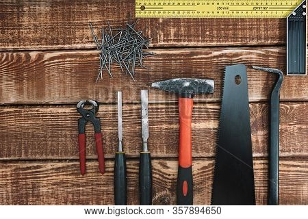 Collection Of Woodworking Tools On A Wooden Background And Copy Space: Carpentry, Craftsmanship And