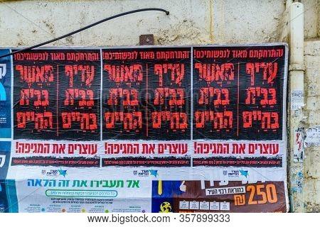 Haifa, Israel - March 18, 2020: Corona Virus Pashkevil - Warning Note For Ultra-orthodox Jews To Sta