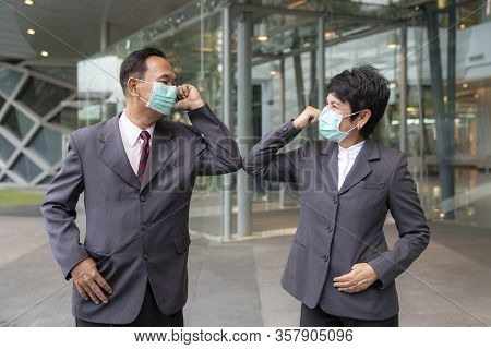 Old Asian Business People Greeting Togather By New Methode With Mask For Prevent Covid 19, This Imag